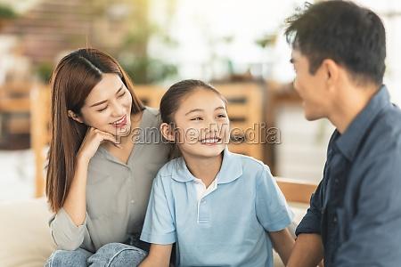 parent having serious conversation with
