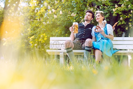 couple in bavaria sitting on bench