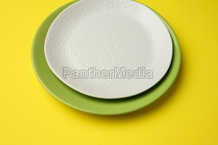 empty round white plate for main