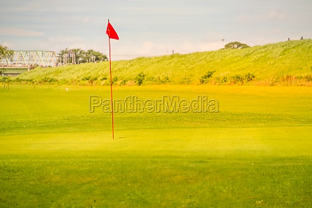 golf course green and flag image