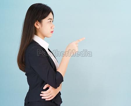 woman looking at camera and pointing