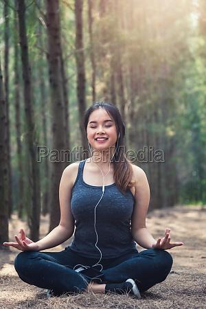 beautiful young woman relaxation sitting meditation
