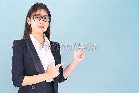 asain women in suit standing using