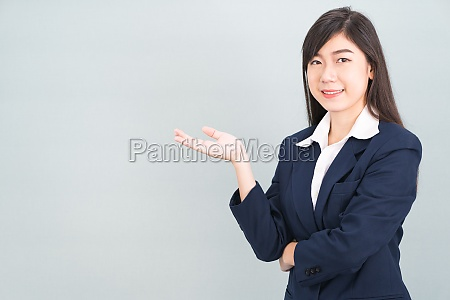 asian woman in suit open hand