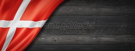 danish flag on black wood wall