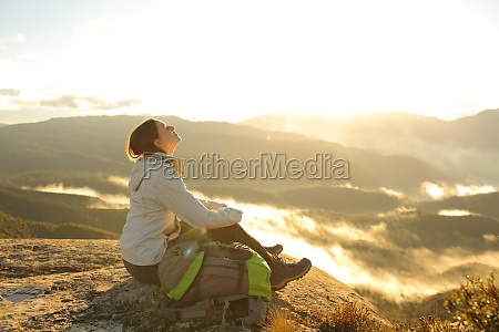 trekker breathing fresh air in the
