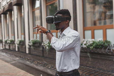 african businessman use virtual reality glasses