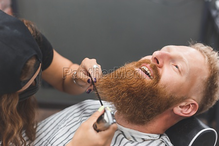 a man at a barbershop woman