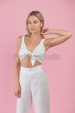young blonde woman in white natural