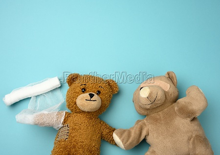 two teddy bears on a blue