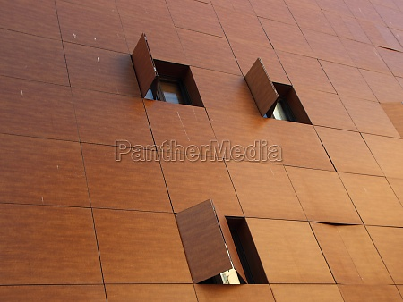 modern wooden building facade with folded