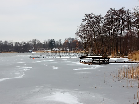 winter lake with frozen water and