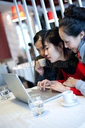 three women spend their leisure time