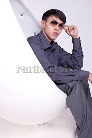a white collar man sitting in