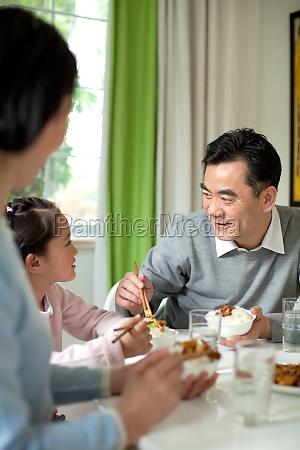 grandfather asians granddaughter smile husband eat