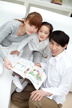 warm parents oriental asians indoor family