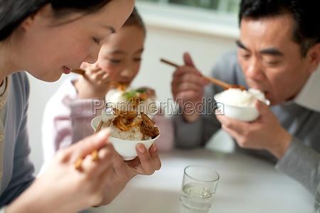 oriental figures family affection women rice