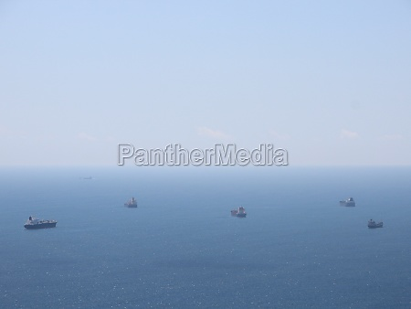 five container ships waiting at open