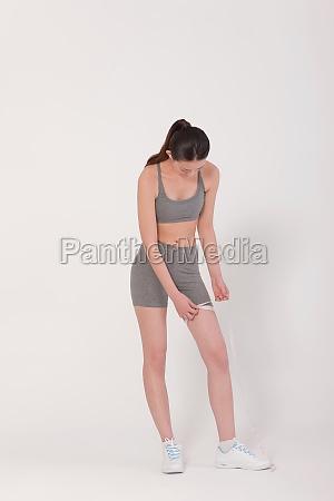 healthy sportswear slim young woman thighs