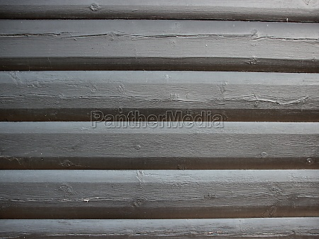 detail of grey wooden fence structure