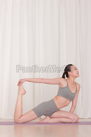 a woman lose weight through yoga