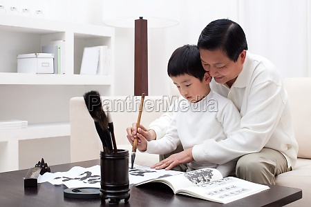 oriental figures children older men warm