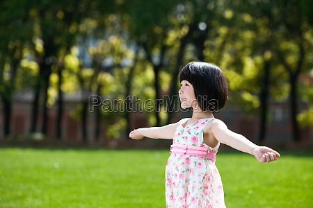 a girl playing outdoors
