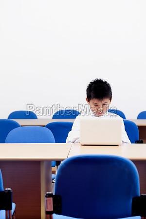 three students in classroom