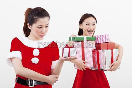 two women buy christmas gifts