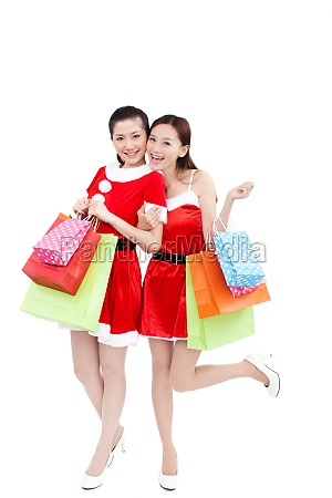 two women buy christmas gifts