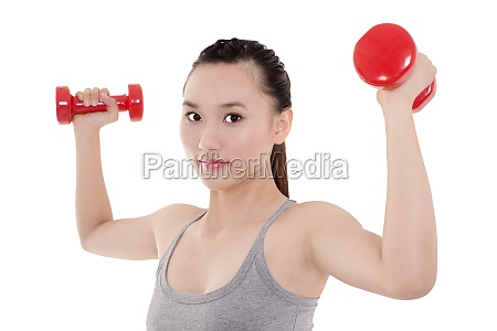 a woman holding a dumbbell exercise
