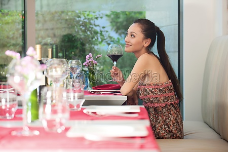 a woman dining at a restaurant