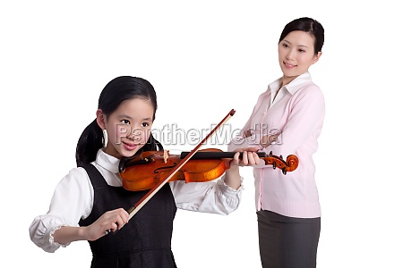 mother urging daughter practicing the violin