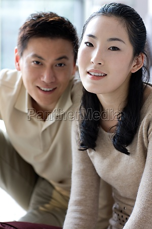 young men smile asia two people