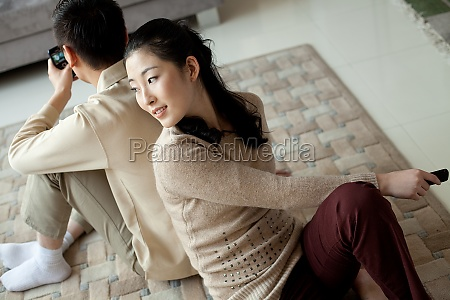 sitting asian family young woman back