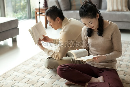 asia smile wife cross legged read