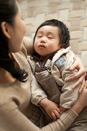 oriental figures intimacy son mother embrace