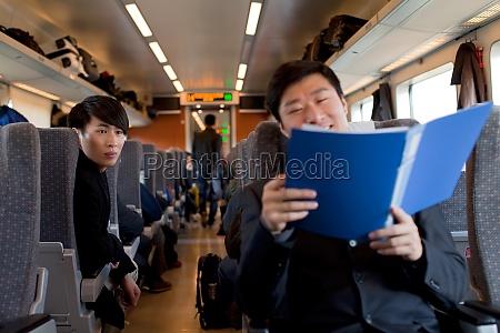 staff two people oriental figures passengers