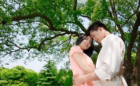 tree two people accompanying husband wife