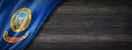 idaho flag on black wood wall
