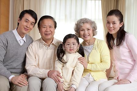 women family photo grandparents oriental figures