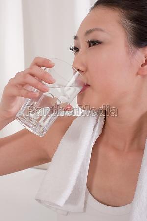 women asian drink water the blue