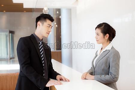 office a man speak two people