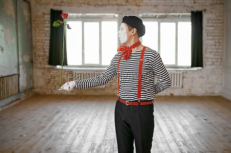 mime artist clown with a rose