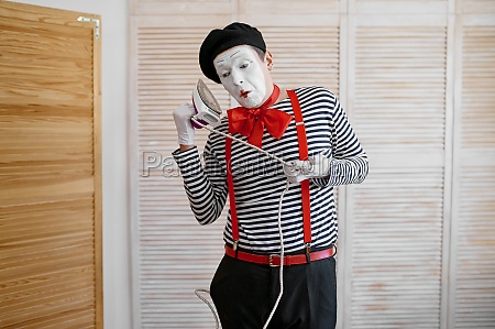 mime artist with an iron phone