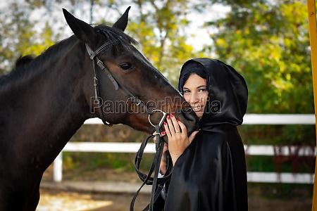 a girl in a black cloak