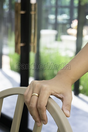 woman hand hold on chair