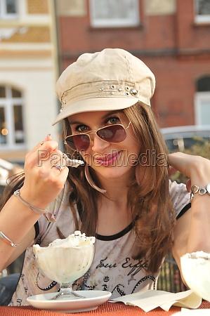 beauty young girl eating icecream