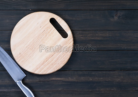 close up kitchen knife and wooden