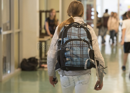 school child with school bag or